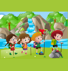 Four kids hiking along the river vector