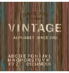 Vintage stamp alphabet and wooden background vector image
