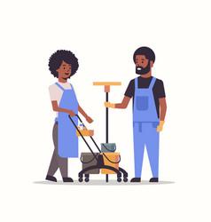 Couple janitors man woman in uniform working vector