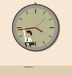 Businessman hangs on an arrow of clock vector image