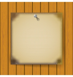 Burnt sheet of paper on a wooden wall vector image vector image
