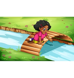A young girl playing at the wooden bridge vector