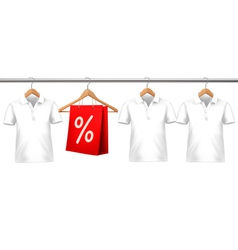 Shirts with price tags hanging on hangers Concept vector image vector image