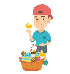 boy holding a cupcake and stroking his belly vector image