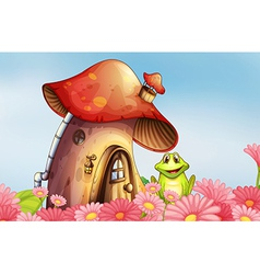 A frog near the mushroom house with a garden of vector image