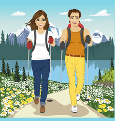 Young couple hiking outdoors in summer mountains vector