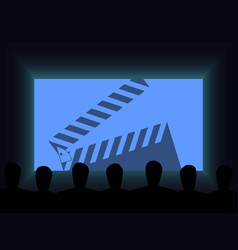 People in the cinema watch a movie clapperboard vector