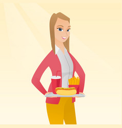 Woman holding tray full of fast food vector