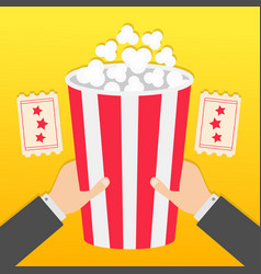 two human businessman hands holding big popcorn vector image