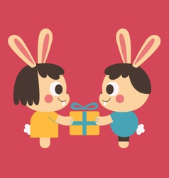 Bunny couple trading a present vector