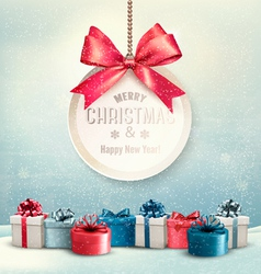 Merry Christmas card with a ribbon and gift boxes vector