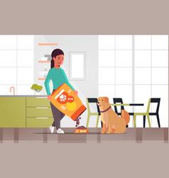 woman feeding hungry labrador retriever girl vector image