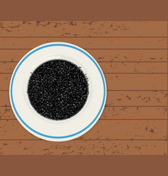 Black cumin seeds in a plate on a wooden planks vector
