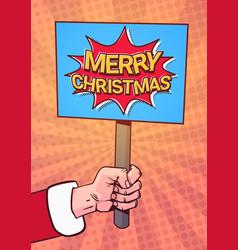 santa hand hold merry christmas banner pop art vector image