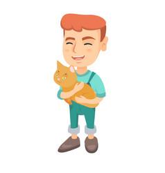 caucasian happy boy holding a cat vector image