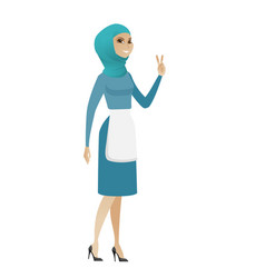 young muslim cleaner showing victory gesture vector image