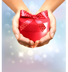 Holiday background with hands holding gift box vector image vector image