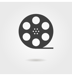 Film reel icon with shadow vector