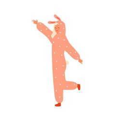 Funny young woman dancing in rabbit kigurumi vector