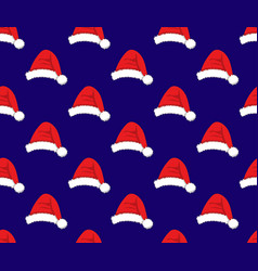 red santa hat on blue background vector image