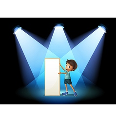 A boy holding an empty board with spotlights vector image