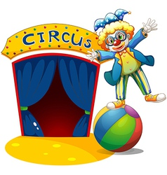A clown at the top of the ball beside a circus vector image