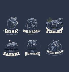 Set of vintage wild boar emblems vector