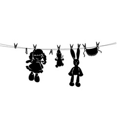 silhouette toys drying on rope after washing vector image