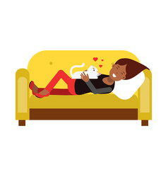 Young woman lying on an yellow sofa and embracing vector