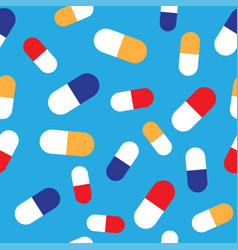 seamless pattern with pills and capsules on blue vector image