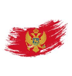 montenegrian flag grunge brush background vector image