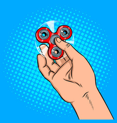 Spinner in hand pop art vector