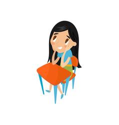 little schoolgirl sitting at the desk preschool vector image