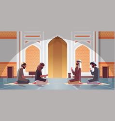 Religious muslim men kneeling and praying inside vector