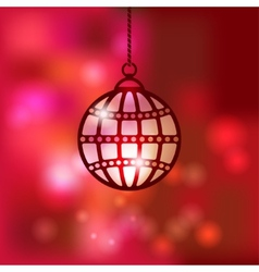 Christmas ball on red blurred background vector image