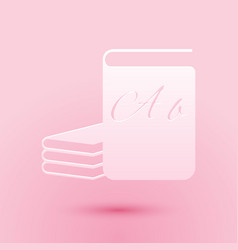 Paper cut abc book icon isolated on pink vector