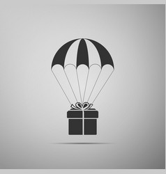 gift box flying on parachute on grey background vector image