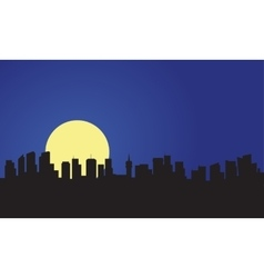 Silhouette of building and full moon vector