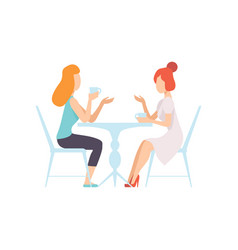 Two beautiful women friends sitting in cafe vector