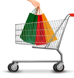 Shopping cart with colorful shopping bags Discount vector image vector image