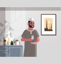 Arabic man in traditional clothes drinking coffee vector