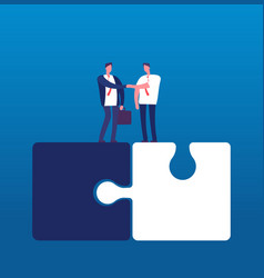 businessmen with puzzle man handshaking on huge vector image