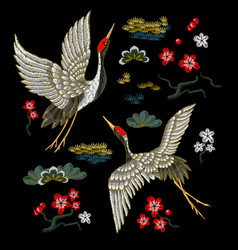 Japanese white cranes with red flowers vector