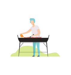 young man cooking barbecue on grill outdoor vector image
