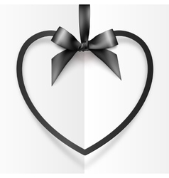 Black heart shape frame hanging on silky ribbon vector image