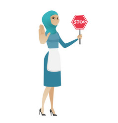 young muslim cleaner holding stop road sign vector image vector image