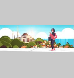 Arabic woman walking outdoor arab businesswoman vector