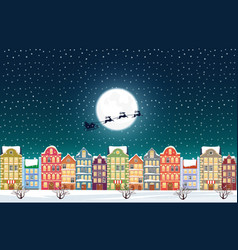 santa claus flies over a decorated snowy old city vector image