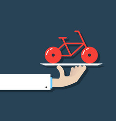 Hand holding bicycle on dish vector