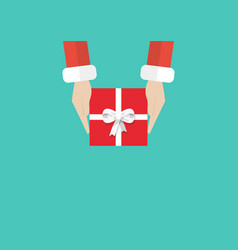 santa hands holding gift or present box vector image